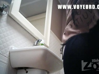 A girl in blue panties pissed standing. Hidden camera in the women's toilet