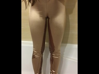 Wetting her gold pants