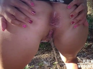 Hot sexy mom peeing in public park. 60fps