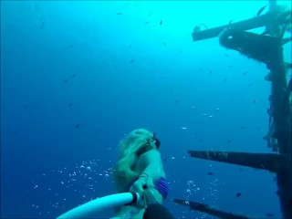 Sexy Blonde Asian Girl Snorkeling Breath Holding in the Ocean